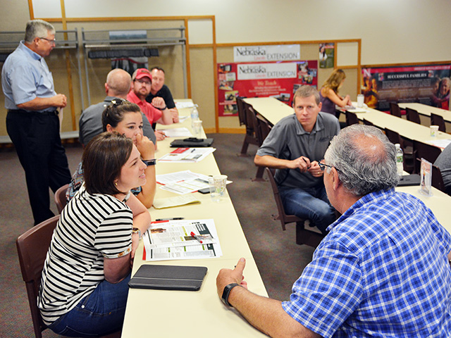 At a University of Nebraska-Lincoln Extension meeting about farm stress, attendees break into small-group discussion about how stress affects them individually. (Progressive Farmer image by Russ Quinn)