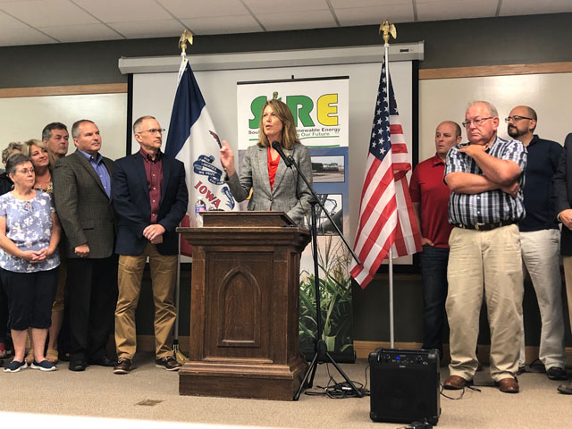 Rep. Cindy Axne, D-Iowa, speaks with farmers, ethanol industry representatives and local officials at Southwest Iowa Renewable Energy near Council Bluffs, Iowa. Two months ago, the plant hosted President Donald Trump, but the ethanol industry took a blow with EPA approving 31 small-refinery waivers earlier this month. (DTN photo by Chris Clayton)