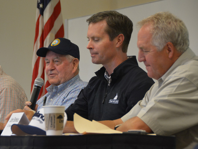 Agriculture Secretary Sonny Perdue answers a question at a listening session during the Farm Progress Show outside of Decatur, Illinois, on Wednesday. With Perdue were GOP Reps. Rodney Davis (center) and John Shimkus, both of Illinois. Fellow Illinois Reps. Mike Bost and Darin LaHood, also attended. (DTN photo by Chris Clayton)