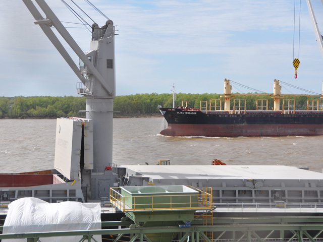 A ship passes another ship at port along the Parana River near Rosario, Argentina. (DTN Photo by Chris Clayton)