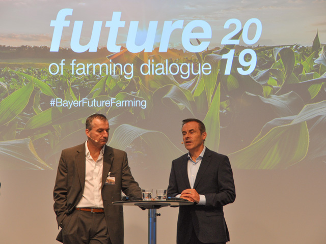 Bob Reiter (left) and Liam Condon (right) talk about Bayer's new products and research at the company's annual Future of Farming Dialogue hosted in Germany this week. (DTN photo by Emily Unglesbee)