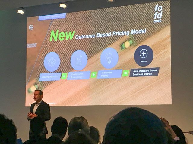 Liam Condon presents the company's pilot program on Outcome Based Pricing at Bayer's annual Future of Farming Dialogue underway in Germany this week. (DTN photo by Emily Unglesbee)