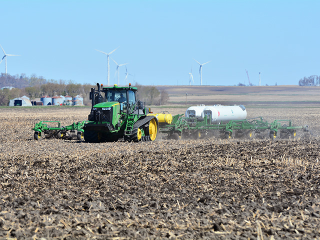 A farmer near Britt, Iowa, injects anhydrous ammonia this spring before planting corn. (Progressive Farmer photo by Matthew Wilde)