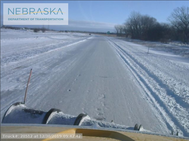 Snowplow action on Interstate 80 near Grand Island, Nebraska is an example of slowdowns and stoppages to travel and transportation caused by the big central U.S. storm during the final weekend of 2019. (Nebraska Road Department photo)