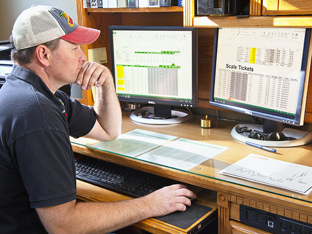Shane Sand tracks costs, such as land, loans, repairs, grain storage, freight and drying, with a master Excel sheet. (Progressive Farmer image by John Borge)
