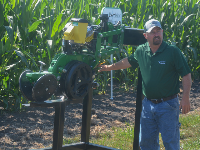 Precision Planting agronomist Jason Webster tells farmers about various corn research studies, including nutrient banding, last summer at the company's Precision Technology Institute in Pontiac, Illinois. Webster runs the research farm. (Progressive Farmer photo by Matthew Wilde)
