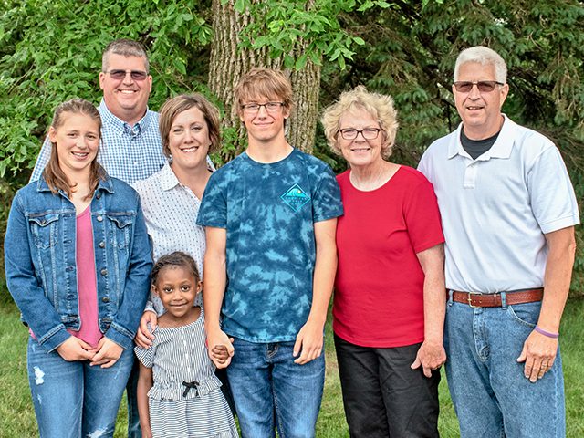 Four generations of Landuyts have farmed in Minnesota, including (left to right) Hallie, Mike, Kari, Harper (front), Hayden, Kris and George. (Progressive Farmer image Courtesy of NCBA Environmental Stewardship Award Program)