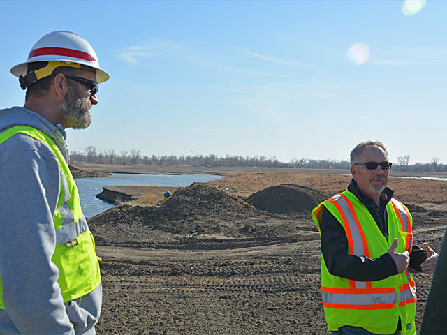 Todd Tobias, a construction manager for the U.S. Army Corps of Engineers, (left) and John Askew, a Fremont County, Iowa, farmer, each explain some of the levee repair work done on the Missouri River as Iowa officials and local farmers sought to show USDA crop insurance staff and others the improvements that have been made since last year's flood. (DTN photo by Chris Clayton)