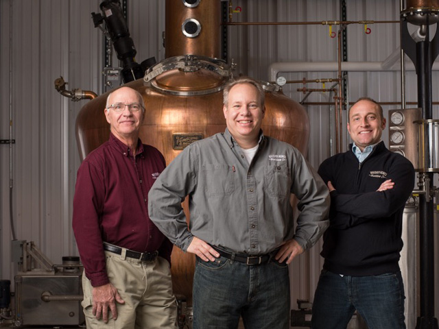 From left, Jim Walter, farmer and co-owner of Whiskey Acres Distilling Company; Jamie Walter, president and CEO of the company; and Nick Nagle say the sanitizer project has become important to their employees who want to help Americans get through this virus emergency. (Photo courtesy of Whiskey Acres Distilling Company)