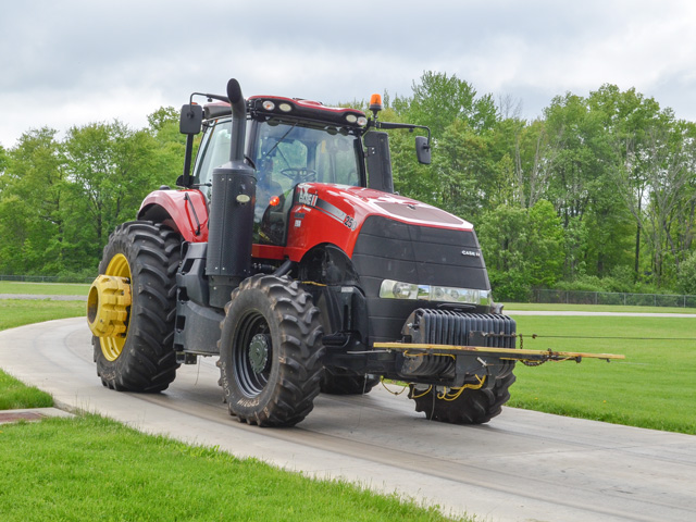 Tethered and overloaded tractors run over a pair of circular tracks paved with various surfaces to simulate extreme wear and tear at Firestone's Ohio test center. Track tests may run 1,600 hours. (DTN/Progressive Farmer photo by Dan Miller)