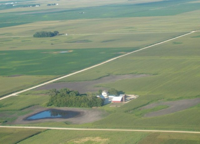 Farm real estate brokers see reason for optimism as commodity prices rise but warn there could be significant variability, especially in areas that struggled with wet weather this spring.