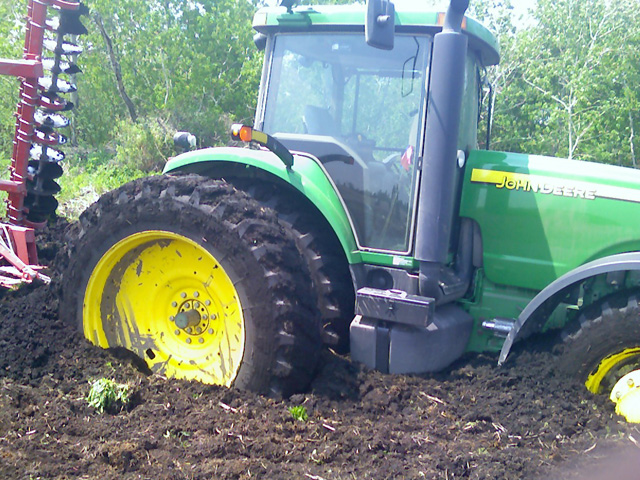 Stuck in the mud with no way to plant? You're not alone. DTN Contributing Analyst Elaine Kub outlines the market implications of prevented planting. (Photo courtesy of Ben Riensche)