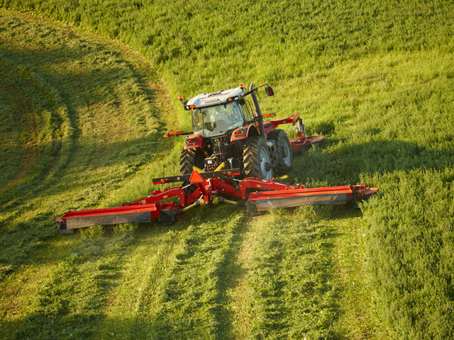 AGCO's new DM1300 series butterfly mower system allows three mowers mounted front and back of a tractor to work in tandem for a 30-foot width cut. The system is branded Hesston by Massey Ferguson. (AGCO photo)