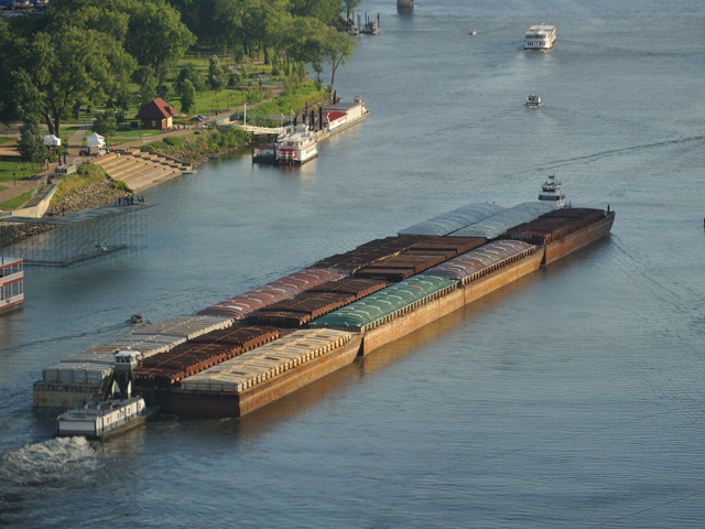 Farm groups and others who work on inland waterways praised President Donald Trump on Wednesday for focusing on dilapidated locks and dams. Pictured here are grain barges moving on the Mississippi River at St. Paul, Minnesota. (DTN/The Progressive Farmer file photo by Jim Patrico)