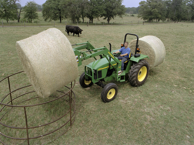 Many forage producers now use plastic net-wrap coverings to protect round bales from the effects of weather and to save time while baling. (DTN/The Progressive Farmer file photo)
