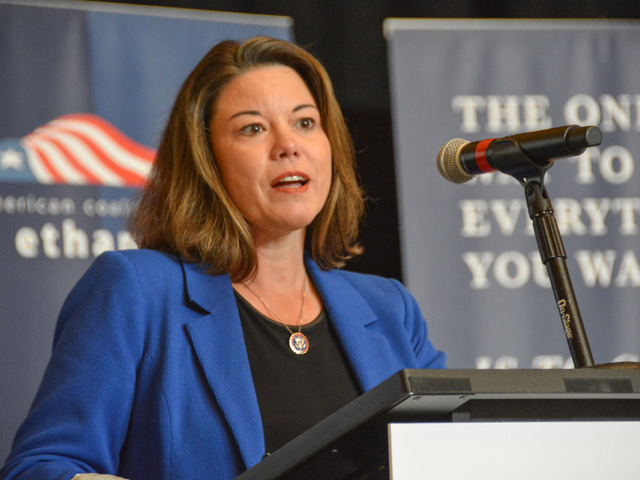 Rep. Angie Craig, D-Minn., spoke Thursday at the American Coalition for Ethanol meeting in Minneapolis. Craig, who sits on both the House Agriculture and Energy and Commerce committees, is working to get language in the budget reconciliation bill that would ensure 15% ethanol can be sold year-round despite a court ruling earlier this summer that threw out an EPA rule. (DTN photo by Chris Clayton)