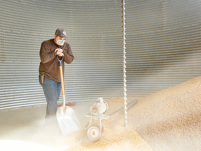 A sweep auger can be a useful tool to clean out bins, but it is also dangerous and can lead to a farm accident in a split second. (DTN/Progressive Farmer file photo by Hal Maggiore)
